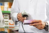 Pharmacist Scanning Prescription
